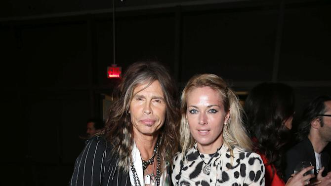 Steven Tyler and guest at New Line Cinema's World Premiere of 'The Incredible Burt Wonderstone' held at Grauman's Chinese Theatre on Monday, Mar., 11, 2013 in Los Angeles. (Photo by Eric Charbonneau/Invision for New Line Cinema/AP Images)