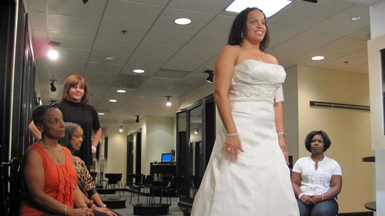 "Kristie trying on wedding gown on ""Say Yes to the Dress: Atlanta."""