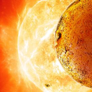 This artist's rendering provided by the Harvard-Smithsonian Center for Astrophysics on Wednesday, Oct. 30, 2013 shows the planet Kepler-78b, foreground, orbiting less than one million miles from its sun. Astrophysicists reported Wednesday in the journal Nature that the exoplanet appears to be made of rock and iron just like Earth. (AP Photo/Harvard-Smithsonian Center for Astrophysics, David A. Aguilar)