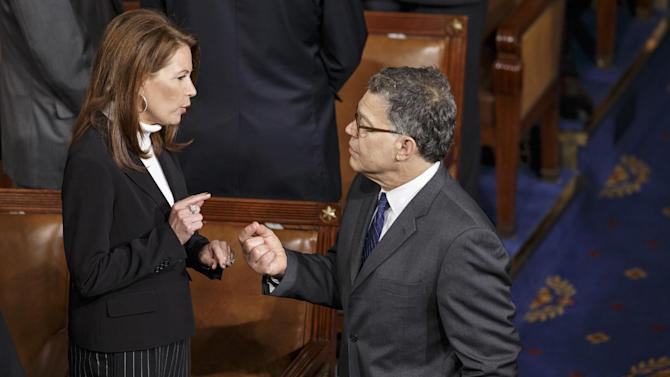 Rep. Michele Bachmann, R-Minn., left, and Sen. Al Franken, D-Minn., talk as lawmakers gather in the chamber of the House of Representatives for a joint meeting of Congress, at the Capitol in Washington, Thursday, Sept. 18, 2014, before a speech by visiting Ukranian President Petro Poroshenko. The House and Senate are wrapping up business and heading to their home states for the weeks leading up to the midterm elections. (AP Photo/J. Scott Applewhite)