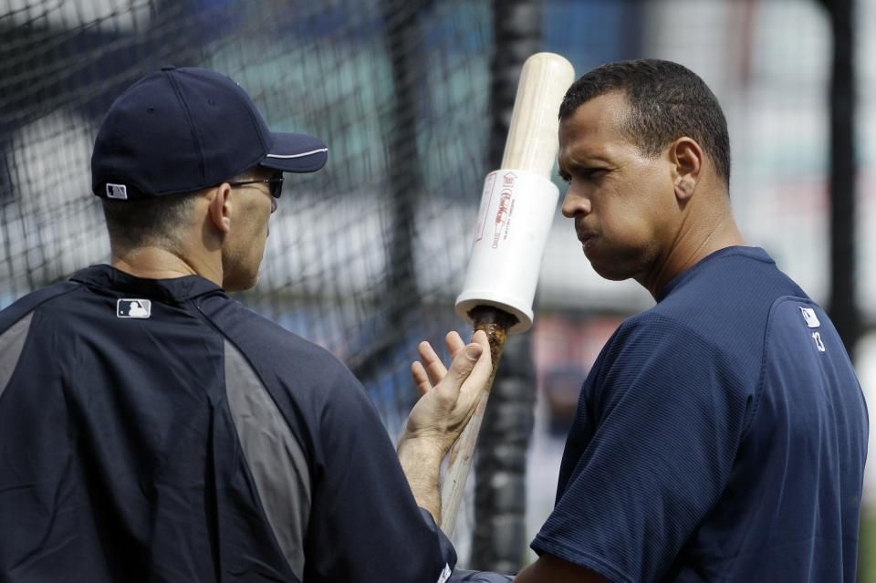 New York Yankees' Alex Rodriguez, right, and manager Joe Girardi talk during practice at baseball spring training, Saturday, Feb. 25, 2012, in Tampa, Fla. (AP Photo/Matt Slocum)