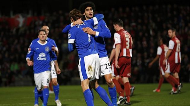 Jelavic of Everton celebrates with Fellaini after scoring his team&#39;s first goal against Cheltenham Town during their FA Cup third round match at the Abbey Business Stadium in Cheltenham