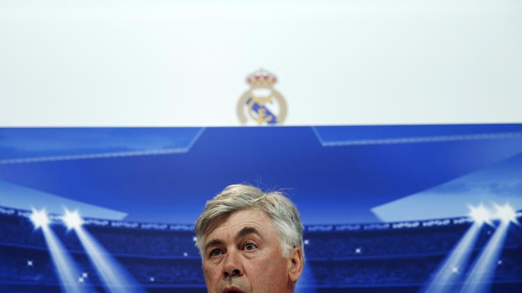 Real Madrid's coach Ancelotti attends a news conference on the eve of their Champions League soccer match against Schalke 04 at the Valdebebas training grounds, outside Madrid