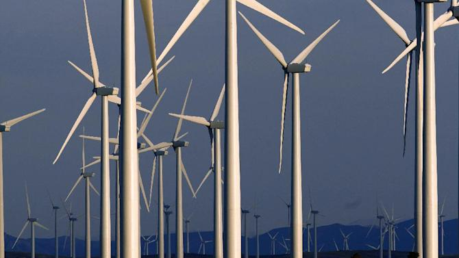 FILE - This May 6, 2013 file photo shows a wind turbine farm owned by PacifiCorp near Glenrock, Wyo. Wind farm operator PacifiCorp Energy will pay $2.5 million in fines after pleading guilty Friday, Dec. 19, 2014, in federal court to charges related to the deaths of protected birds in Wyoming. (AP Photo/Matt Young)