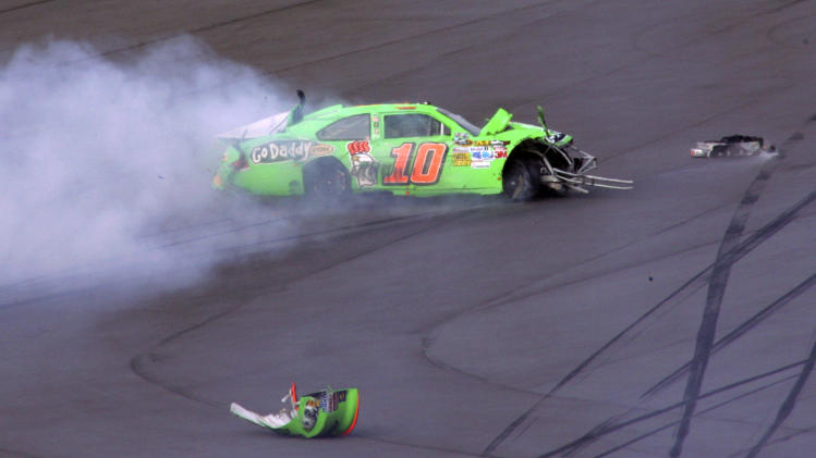 Danica Patrick's car slides down the track after a crash during the first of two NASCAR Daytona Duel 150 qualifying auto races in Daytona Beach, Fla., Thursday, Feb. 23, 2012. (AP Photo/Jim Topper)