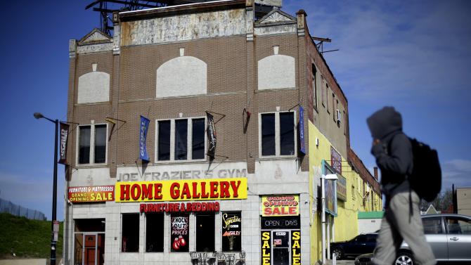 Shown is a present day furniture store and the former gym where heavyweight champ Joe Frazier lived and trained, on Tuesday, April 30, 2013, in Philadelphia. The gym has been named to the National Register of Historic Places.  (AP Photo/Matt Rourke)