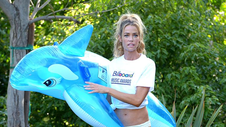 Denise Richards Having Fun Pool Side