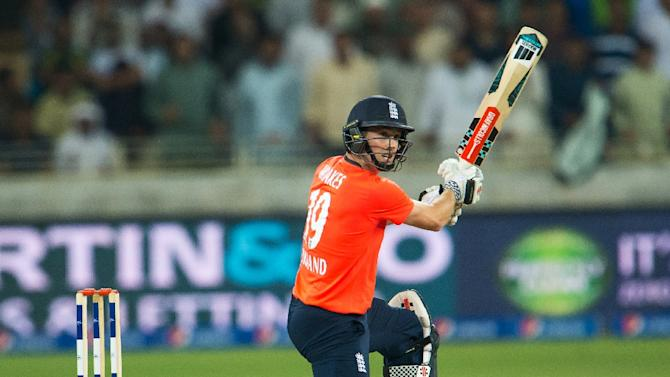 England's Chris Woakes plays a shot during the second T20 cricket match between Pakistan and England at the Dubai International Cricket Stadium in Dubai on November 27, 2015