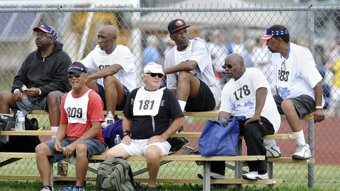 IMAGE DISTRIBUTED FOR U.S. DEPARTMENT OF VETERANS AFFAIRS - U.S. veteran senior athletes take a break during day one of competition at the National Veterans Golden Age Games hosted by the U.S. Department of Veterans Affairs on Saturday June 1, 2013 in Orchard Park, N.Y. (Dan Cappellazzo/AP Images for U.S. Department of Veterans Affairs)
