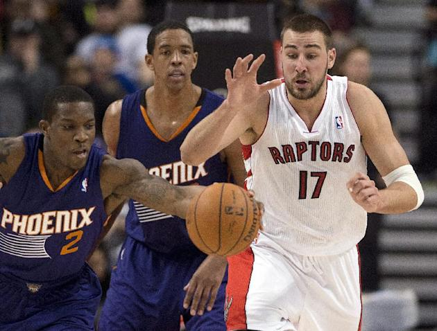 Toronto Raptors center Jonas Valanciunas (17) tries to chase down a loose ball against Phoenix Suns guard Eric Bledsoe (2) during the first half of an NBA basketball game in Toronto on Sunday, March 1