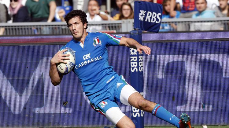 Italy's Sarti scores during the match against England in their Six Nations rugby union match at Olympic Stadium in Rome