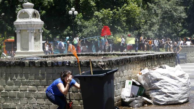 Student takes cover during a demonstration near Ministry of Education at Santiago