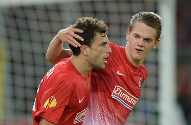 Admir Mehmedi , left,  of Freiburg celebrates with Matthias Ginter after scoring  agoal  during the UEFA Europa League Group H   soccer match between SC Freiburg and Slovan Liberec FC at Mage Solar St