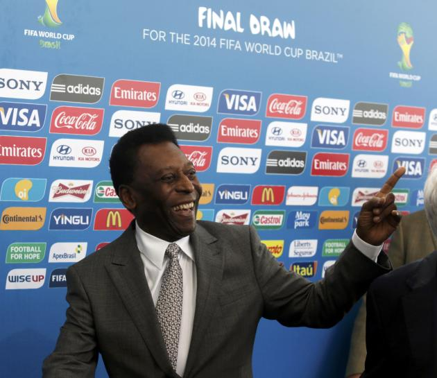Former Brazil soccer player Pele arrives for the draw for the 2014 World Cup at the Costa do Sauipe resort in Sao Joao da Mata