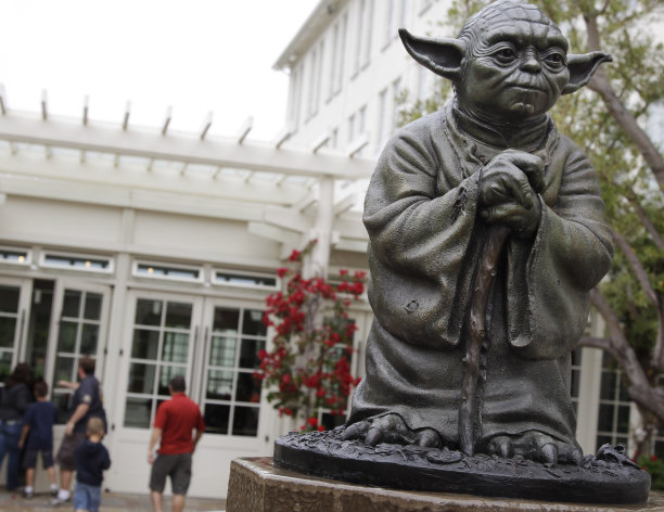 FILE - This Aug. 2, 2011 file photo shows a life-sized replica of Yoda, George Lucas' master of the Force, at Lucasfilm Ltd. production studios in San Francisco. The Northern California city of San Anselmo has approved a new downtown park to be built on land donated by Lucas that will feature statues of Indiana Jones and Yoda, two of his most popular characters. (AP Photo/Paul Sakuma, File)