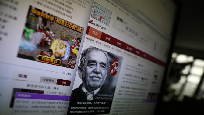 """A purple dialog box announces the temporary closure of the literature site as it undergoes """"a self-correction action"""" on the Chinese web giant Sina.com books site displayed on a computer in Beijing, China, Friday, April 25, 2014. Chinese web giant Sina.com temporarily closed its literature site Friday after reports it would lose two crucial publication licenses for hosting pornography. Sina decided to take books off its site while it undergoes """"a self-correction action"""" to screen their content, according to a notice on its reading channel. Book reviews, cultural news, author biographies and interviews were still available.(AP Photo/Ng Han Guan)"""
