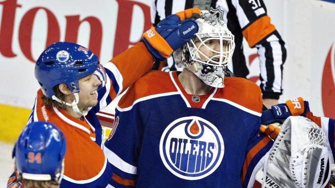 Oilers' Scrivens sets shutout record with 59 saves
