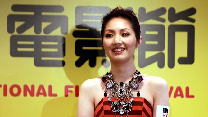 In this Feb. 21, 2013 photo released by China's Xinhua News Agency, the ambassador of the 37th Hong Kong International Film Festival Mariam Yeung attends a press conference in Hong Kong. The Hong Kong International Film Festival will start on March 17. (AP Photo/Xinhua, Jin Yi) NO SALES