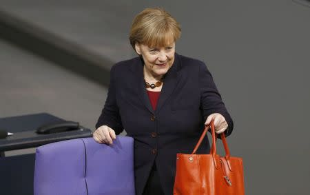 German Chancellor Merkel arives for a session of the Bundestag in Berlin