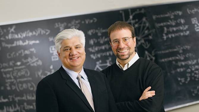 FILE - This undated photo provided by Perimeter Institute shows Mike Lazaridis, left, creator of BlackBerry, and Howard Burton, director of the Perimeter Institute in Waterloo, Ontario, Canada. Research In Motion co-founders Jim Balsillie and Lazaridis have together donated more than $400 million to the community. Lazaridis has donated $150 million to the Perimeter Institute for Theoretical Physics, which he founded in 2000. (AP Photo/Perimeter Institute, File)