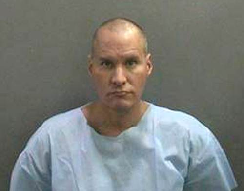 Suspect Marcos Gurrola, 42, of Garden Grove Calif., is seen in an undated photo provided by the Orange County Sheriff's Department. Gurrola was charged with shooting at an inhabited dwelling after firing about 50 shots in the parking lot of the open-air Fashion Island mall Saturday, Dec. 16, 2012. (AP Photo/Orange County Sheriff's Department via Orange County Register) LA TIMES OUT, MAGS OUT