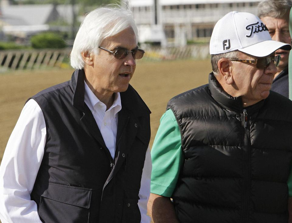 Trainer Bob Baffert, left and Bernie Schiappa walk off the track after watching Bodemeister in a morning workout at Pimlico Race Course, Thursday, May 17, 2012, in Baltimore. Bodemeister is entered in Saturday's Preakness Stakes at Pimlico. (AP Photo/Garry Jones)