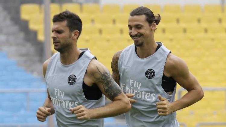 PSG's Ibrahimovic and Motta attend a training session at the Workers Stadium in Beijing