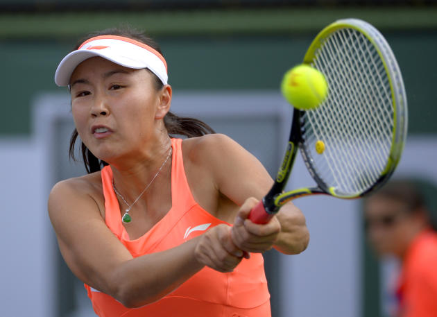 Peng Shuai, of China, returns a volley during a second-round match at the BNP Paribas Open tennis tournament against Eugenie Bouchard, of Canada, Friday, March 7, 2014, in Indian Wells, Calif