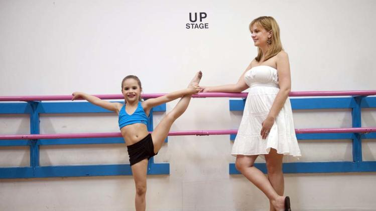 "Mackenzie stretches it out with mom Melissa in ""Dance Moms."""