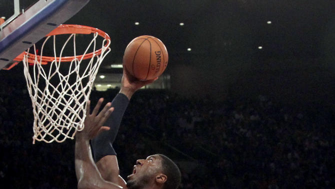 Indiana Pacers' Roy Hibbert (55) shoots past New York Knicks' Tyson Chandler in the first half of Game 2 of their NBA basketball playoff series in the Eastern Conference semifinals at Madison Square Garden in New York, Tuesday, May 7, 2013. (AP Photo/Mary Altaffer)