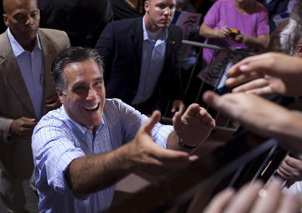 Republican presidential candidate, former Massachusetts Gov. Mitt Romney greets supporters during a campaign rally. Saturday, Sept. 1, 2012, in Cincinnati, Ohio.  (AP Photo/Evan Vucci)
