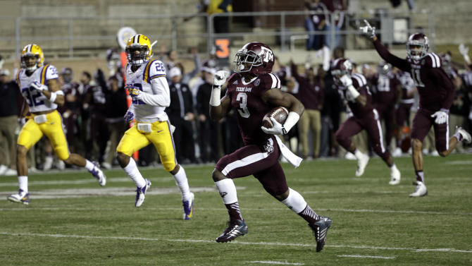 Texas A&M running back Trey Williams (3) rushes for a touchdown against LSU during the first quarter of an NCAA college football game Thursday, Nov. 27, 2014, in College Station, Texas. (AP Photo/David J. Phillip)