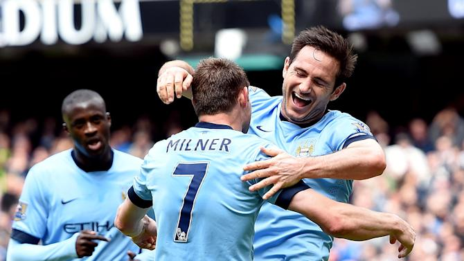 Manchester City's Frank Lampard, right, celebrates scoring against Southampton during the English Premier League soccer match at the Etihad Stadium, Manchester, England, Sunday May 24, 2015. (Martin Rickett/PA via AP) UNITED KINGDOM OUT  NO SALES  NO ARCHIVE
