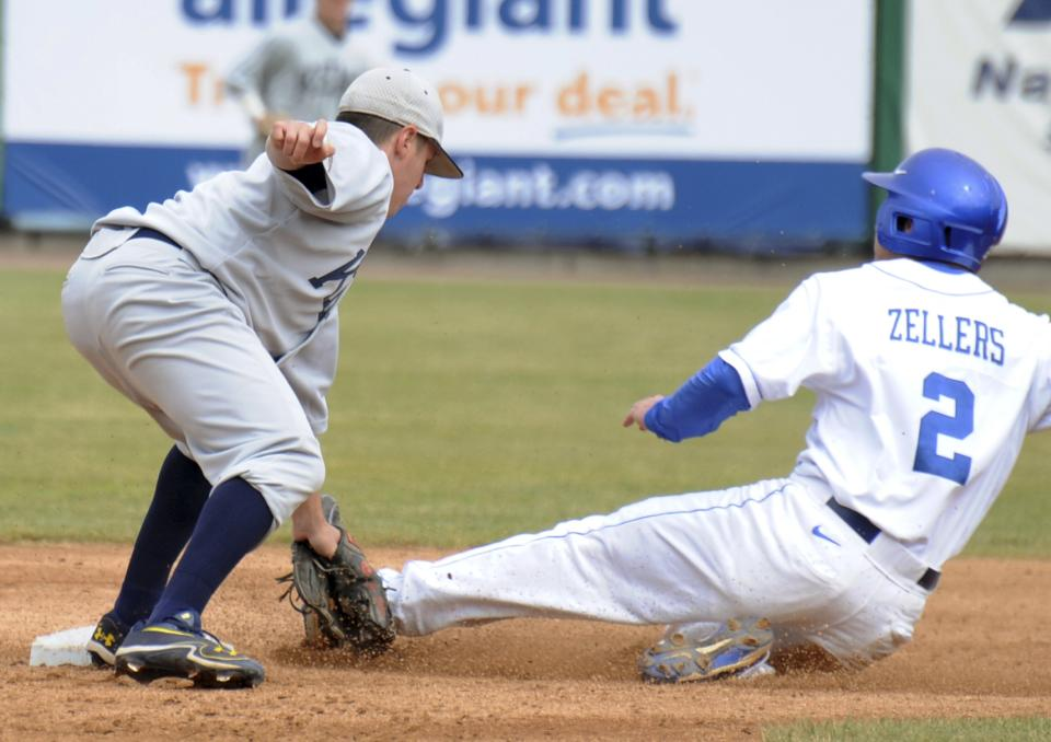 Kent State shortstop Jimmy Rider tags out Kentucky's Zac Zellers during an NCAA college baseball tournament regional game in Gary, Ind., Friday, June 1, 2012. (AP Photo/Joe Raymond)