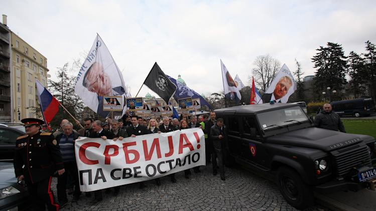 "Protesters carrying a banner that reads: ""Serbia before everything"" during the protest in front of the presidency building in Belgrade, Serbia, Monday, April 8, 2013. Serbia has rejected a European Union-brokered deal for reconciliation with its former province of Kosovo and called for more negotiations with Kosovo Albanian leaders. The EU has given Serbia until Tuesday to say whether it would relinquish its effective control over northern Kosovo in exchange for the start of Serbia's EU membership negotiations. (AP Photo/Darko Vojinovic)"