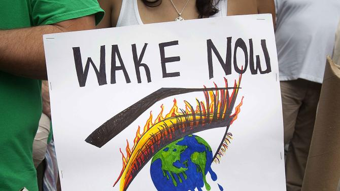 """A protester carries a sign during the """"People's Climate March"""" in the Manhattan borough of New York"""