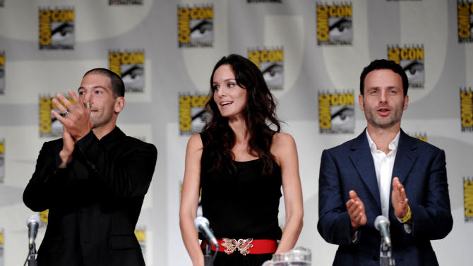 """John Bernthal, left, Sarah Wayne Callies, center, and Andrew Lincoln are shown at a panel for the television series """"The Walking Dead"""" at Comic-Con International 2011 in San Diego Friday, July 22, 2011. The annual comic book and popular arts convention attracts over 100,000 people and runs through Sunday.  (AP Photo/Denis Poroy)"""