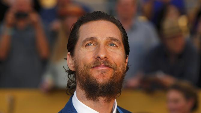 "Actor Matthew McConaughey of the film ""Interstellar"" poses on arrival at the 21st annual Screen Actors Guild Awards in Los Angeles"