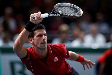 Djokovic of Serbia returns a shot during his men's singles tennis match against Monfils of France in the third round of the Paris Masters tennis tournament at the Bercy sports hall in Paris