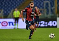 Genoa's forward Marco Borriello runs with the ball during an Italian Serie A football match in September 2012. Genoa climbed up to sixth in the Serie A table after earning a hard-fought point in a 1-1 draw with strugglers Palermo