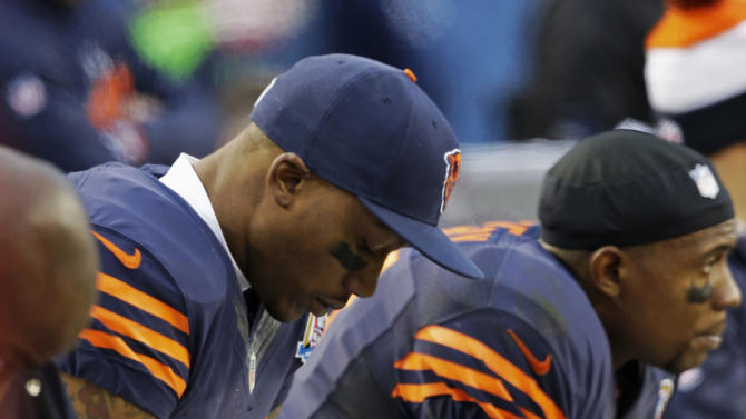 Chicago Bears wide receiver Brandon Marshall (15), second from right, sits on the bench in the second half of an NFL football game against the Green Bay Packers in Chicago, Sunday, Dec. 16, 2012. The Packers won 21-13 to clinch the NFC North division title.(AP Photo/Nam Y. Huh)