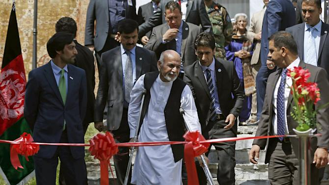 Afghan President Ashraf Ghani arrives to open an exhibition of Afghanistan's products during the RECCA in Kabul