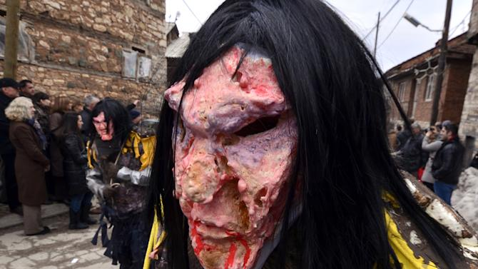 In this picture taken Sunday, Jan. 13, 2013, villagers wear masks of cannibals, made of natural materials, during the carnival in Macedonia's southwestern village of Vevcani.  Said to date from pagan times 1,400 years ago, the Vevcani carnival, with its colorful floats and masked revelers, has grown in popularity over the last decade and attracts thousands of visitors for the celebrations on St. Vasilij Day to welcome in the New Year according to the Julian calendar. (AP Photo/Boris Grdanoski)