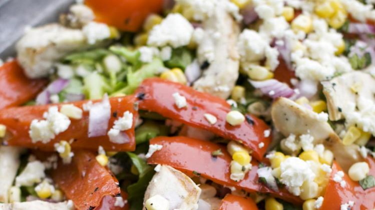In this image taken on May 20, 2013, grilled Greek chicken salad is shown on a serving platter in Concord, N.H. (AP Photo/Matthew Mead)