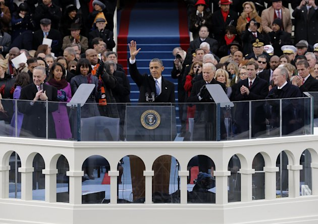 President Barack Obama waves to crowd after his Inaugural speech at the ceremonial swearing-in on the West Front of the U.S. Capitol during the 57th Presidential Inauguration in Washington, Monday, Ja