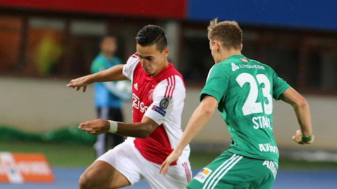 Ajax's Anwar el Ghazi, left, and Rapid's Stefan Stangl challenge for the ball during their the Champions League third qualifying round first leg soccer match between Rapid Vienna and Ajax Amsterdam in Vienna, Austria, Wednesday, July 29, 2015. (AP Photo/Ronald Zak)