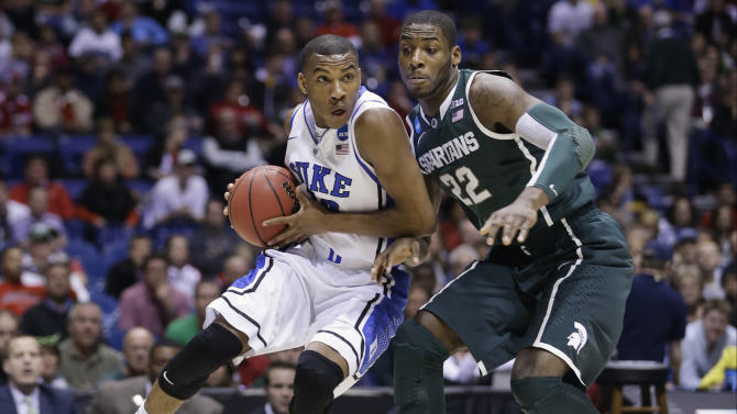 Duke guard Rasheed Sulaimon, left, drives against Michigan State forward Branden Dawson (22) during the first half of a regional semifinal in the NCAA college basketball tournament, Friday, March 29, 2013, in Indianapolis. (AP Photo/Darron Cummings)