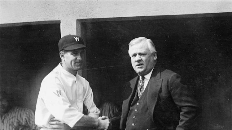 "In this Oct. 4, 1924, photo made available by the Library of Congress, Washington Senators manager Stanley ""Bucky"" Harris, left, and New York Giants manager John McGraw shake hands on the top step of the Giants dugout before the World Series in Washington.Like this year's Washington Nationals, the 1924 World Series champion Washington Senators generated excitement in a city starved for a baseball winner. The Nats will begin their quest for the city's second championship when the playoffs begin this weekend.(AP Photo/Library of Congress)"