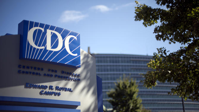 FILE - In this Tuesday, Oct. 8, 2013, file photo, a sign marks the entrance to the federal Centers for Disease Control and Prevention,in Atlanta. The agency released its first progress report Thursday, and CDC officials said they're mostly pleased. (AP Photo/David Goldman, File)