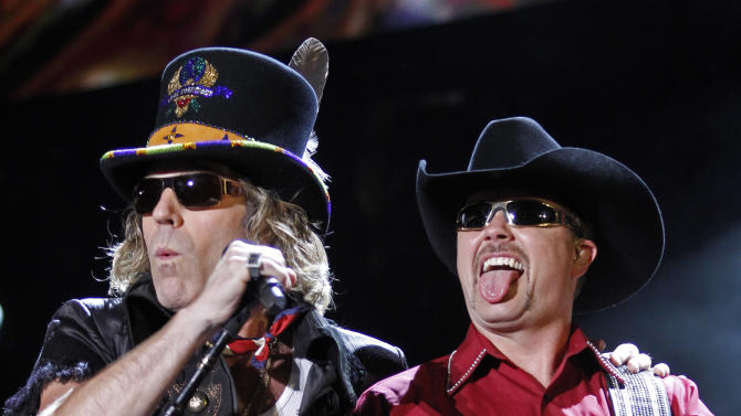 "FILE - This June 11, 2011 file photo shows Big Kenny, left, and John Rich of the group Big and Rich performing during the CMA Fan Festival in Nashville, Tenn. After a five-year break, Big & Rich are putting the funny back in country music _ with the help of Jon Bon Jovi and Richie Sambora.The unlikely quartet gathered to write two songs for the country duo's new album ""Hillbilly Jedi"" after they struck up a friendship a few years back. (AP Photo/Wade Payne, file)"